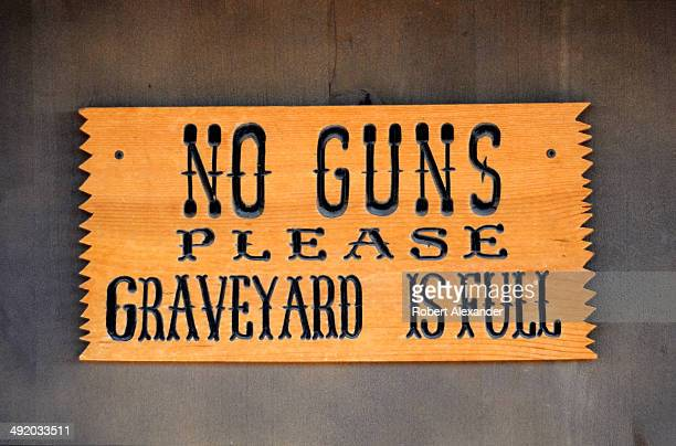 Sign at the entrance to the legendary Boothill Graveyard in Tombstone, Arizona, informs visitors that guns are not allowed. The historic 19th century...