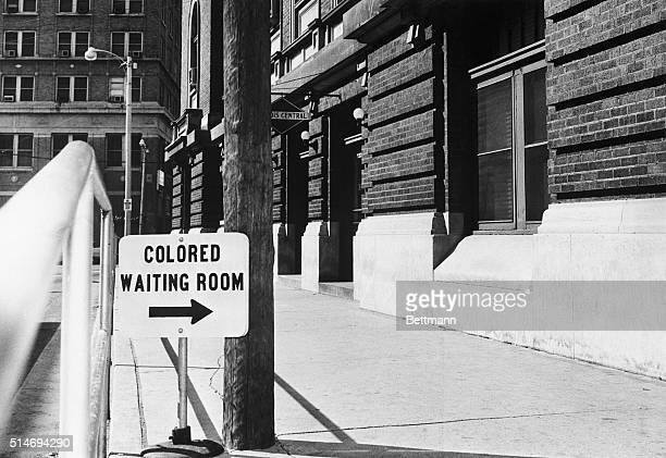 "Sign at the Illinois Central Railroad in Jackson, Mississippi, reads ""Colored Waiting Room""."
