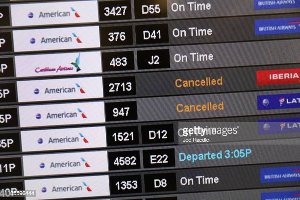 A sign at the Miami International Airport shows cancelled flights as American Airlines grounds it Boeing 737 Max 8 planes on March 13 2019 in Miami...