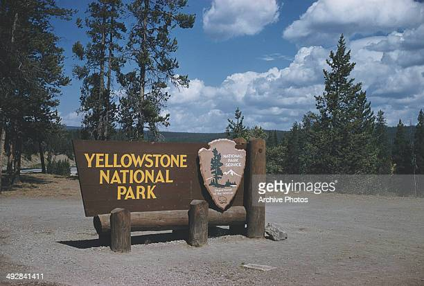 Sign at the south entrance to Yellowstone National Park, Wyoming, courtesy of the National Park Service, Department of the Interior, USA, circa 1965.