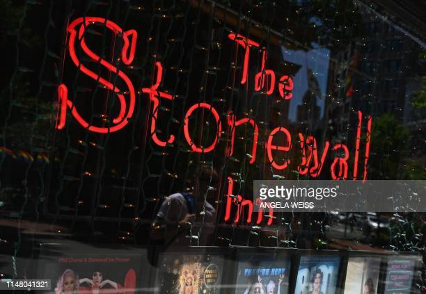 A sign at 'The Stonewall Inn' a Gay bar National Historic Landmark and site of the 1969 riots that launched the gay rights movement is seen on June 4...