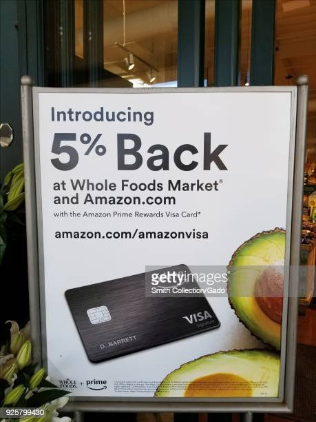 Sign at Whole Foods market grocery store in San Ramon California announcing promotion in which Amazon Prime credit card holders receive a 5% discount...