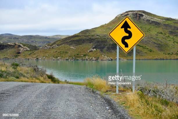 Sign Attention curves along the natural road, Laguna Amarga, Torres del Paine National Park, Ultima Esperanza Province, Chile