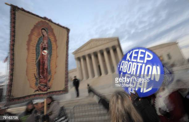 A sign bearing the image of a fetus is placed on a tapestry of the Virgin Mary during the 'March for Life' 22 January 2008 outside the US Supreme...