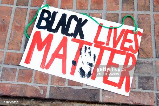 """Sign """"Black Lives Matter"""" is abandoned on the street by the Grove shopping center in the Fairfax District of Los Angeles on May 30, 2020 following a..."""