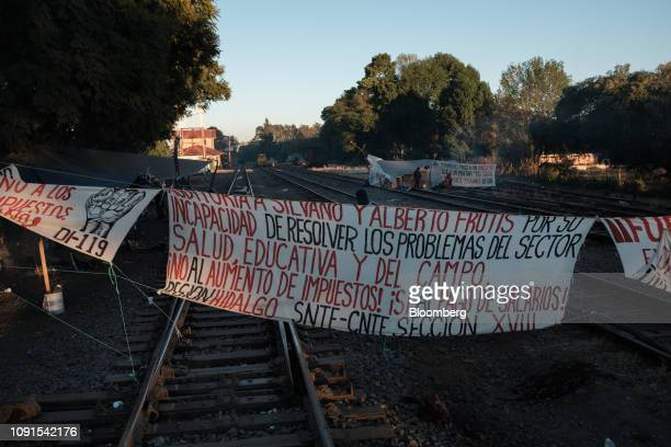 A sign blocks train tracks during a teachers' union strike in the town of Maravatio Michoacan state Mexico on Wednesday Jan 30 2019 Teachers'...
