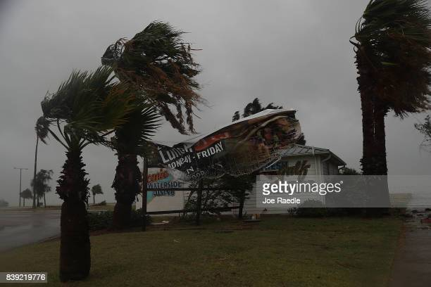 A sign blows in the wind after being partially torn from its frame by winds from Hurricane Harvey on August 25 2017 in Corpus Christi Texas Hurricane...