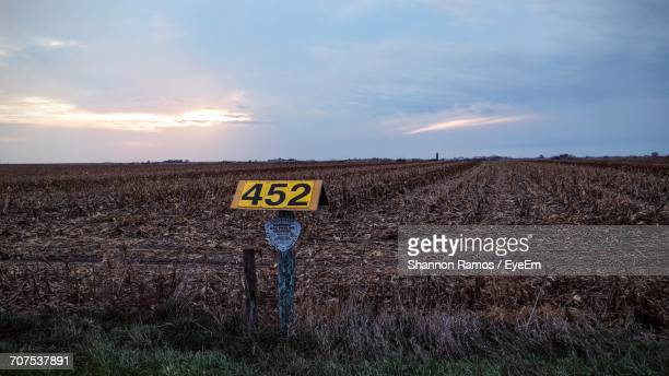 Sign Board At Farm Against Cloudy Sky During Sunset