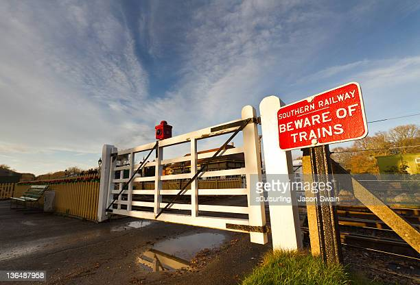 sign board at rail track - s0ulsurfing stock pictures, royalty-free photos & images