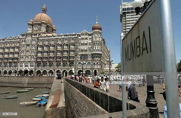 A sign board 'Mumbai' is placed near the Taj hotel at the famous landmark the Gateway in Bombay 13 May 2005 Since independence in 1947 regional...