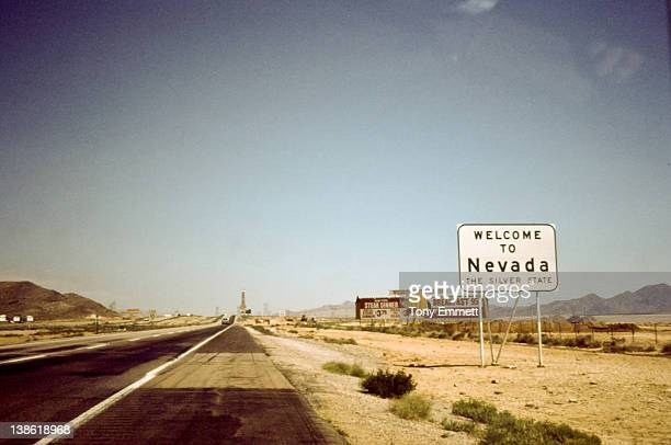 Sign board of 'welcome to Nevada' on road