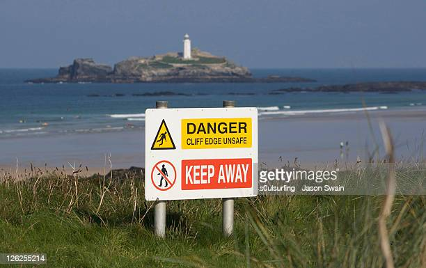 sign board with godrevy lighthouse - s0ulsurfing stock pictures, royalty-free photos & images