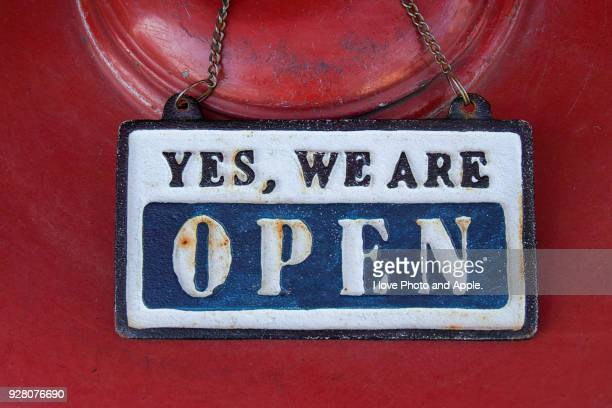Sign board, 'YES, WE ARE OPEN'