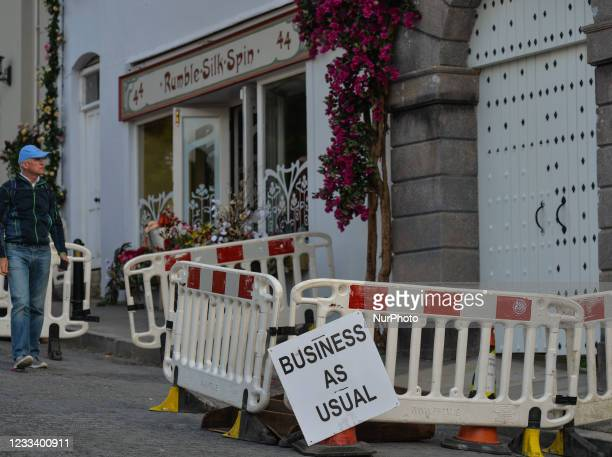 Sign 'Business as usual' seen outside business premises in the village of Enniskerry in County Wicklow. There are only two more days until filming...