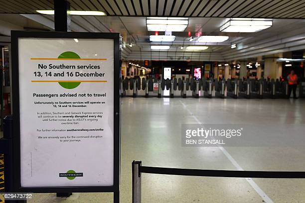 A sign by Southern Rail tells passengers of strike action at Victoria station in London on December 13 2016 Hundreds of thousands of British...