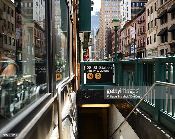 sign by staircase of subway station in city - underground sign stock pictures, royalty-free photos & images