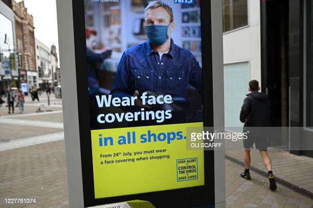 Sign calling for the wearing of face coverings in shops is displayed in the city centre of Leeds, on July 23 as lockdown restrictions continue to be...