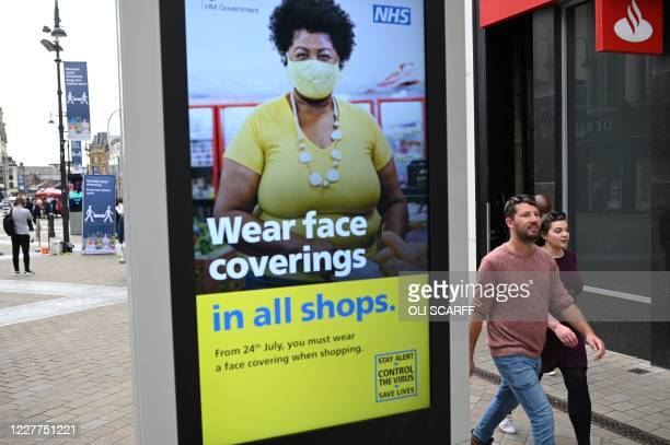 A sign calling for the wearing of face coverings in shops is displayed in the city centre of Leeds on July 23 as lockdown restrictions continue to be...