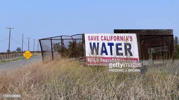 Sign calls for dam water to help the agricultural communities of California's San Joaquin Valley on the outskirts of Lemoore, California on March 31,...