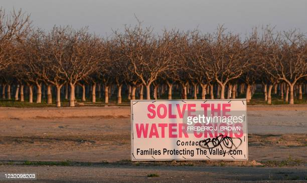 Sign calls for solving California's water crisis on the outskirts of Buttonwillow in California's Kern County on April 2 one of the top agriculture...