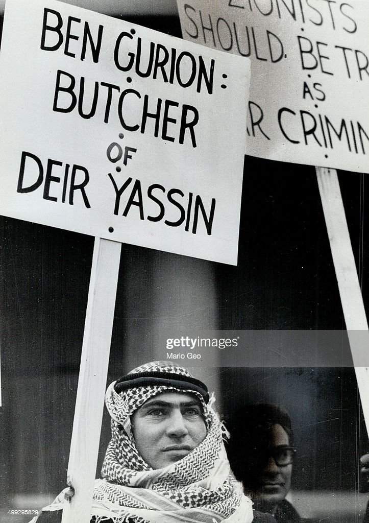 Sign carried by Arab demonstrator outside Royal York last night referes to an alleged slaughter of A... : News Photo
