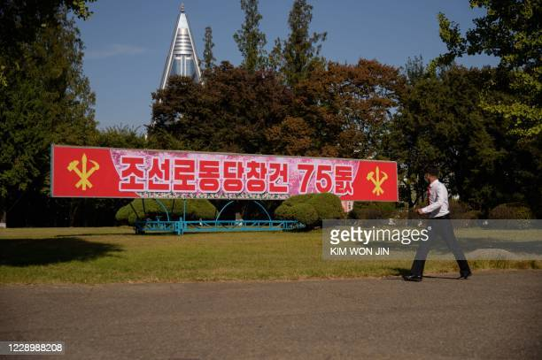 A sign celebrating the 75th founding anniversary of the Workers' Party of Korea is displayed on a street in Pyongyang on October 10 2020 / The...