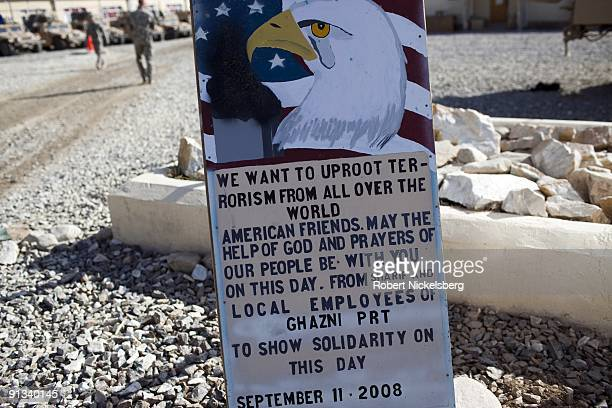 A sign commemorating 9/11 stands on a USCoalition forces base in Ghazni Afghanistan March 19 2009 The US Army soldiers on the Ghazni base are part of...