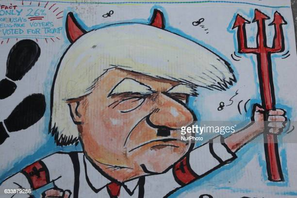 Sign comparing President Donald Trump to Adolf Hitler and the devil as thousands of Canadians take part in a massive protest against President...