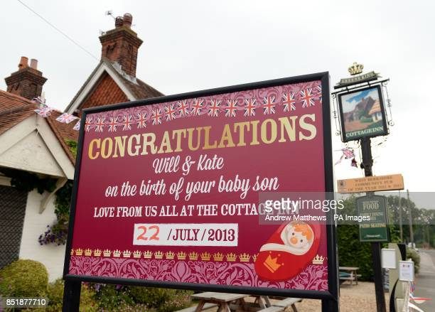 A sign congratulating The Duke and Duchess of Cambridge on the birth of their son is displayed at the Cottage Inn in Bucklebury the family home of...
