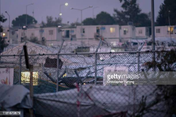 A sign declaring 'Full of Hope' adorns the fencing surrounding the overcrowded Moria Refugee Camp on October 17 2019 in Mytilene Greece Moria migrant...
