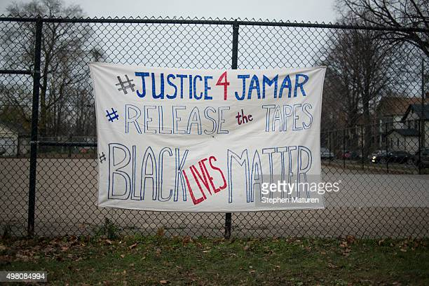 A sign demanding the release of video footage of the killing of Jamar Clark hangs on a fence at a candlelight vigil held for Clark outside the 4th...