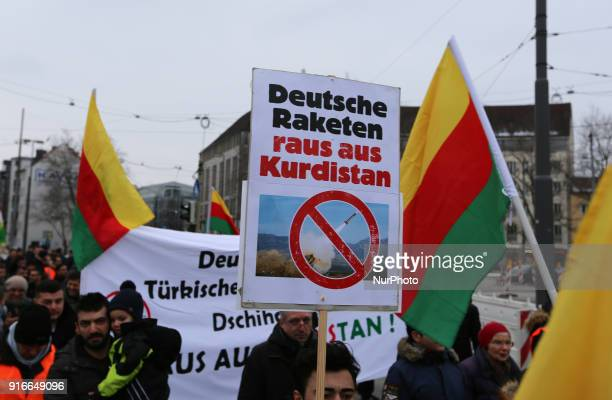 A sign denouncing German arms export to Turkey is seen in the picture Among police more than 250 people demonstrated against the turkish invasion and...