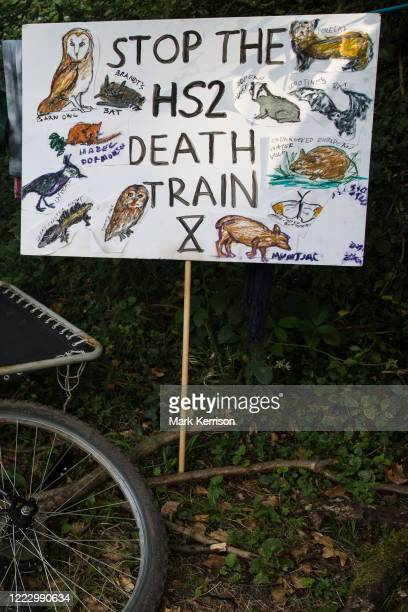 A sign depicting all the species believed to be threatened by the HS2 highspeed rail link stands on the edge of a camp pitched by activists from HS2...