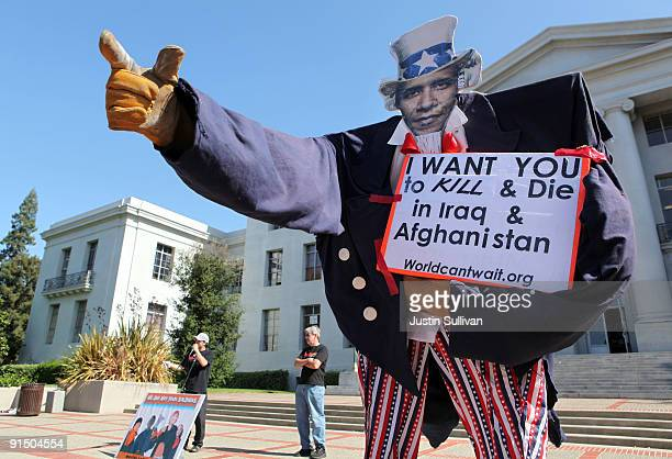 A sign depicting US Preisdent Barack Obama as Uncle Sam is displayed during a protest against the war in Afghanistan on the UC Berkeley campus...