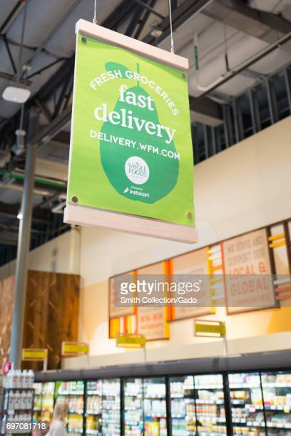 A sign describes grocery delivery services at Whole Foods Market grocery store in Dublin California June 16 2017 On June 16 Amazoncom announced that...