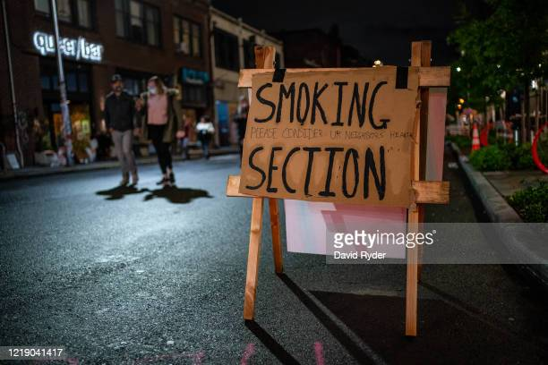 Sign designates a smoking section near the Seattle Police Departments East Precinct on June 9, 2020 in Seattle, Washington. Protests have continued...