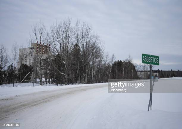 A sign designating the town line stands in Asbestos Quebec Canada on Friday Feb 9 2018 Quebec once produced half of the world's asbestos and offered...
