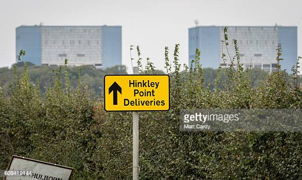 A sign directing construction traffic to the new site of the new Hinkley Point power station is seen in front of the old Hinkley Point A buildings...
