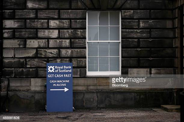A sign directing customers to an automated teller machine reads 'Get Cash Fast' as it stands outside the Royal Bank of Scotland Plc's headquarters in...