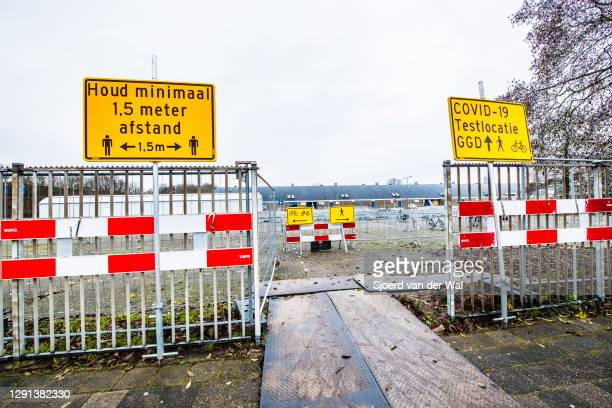 Sign directing to the COVID-19 coronavirus test location for testing by the Region Zwolle GGD IJsselland Dutch Municipal health service on December...