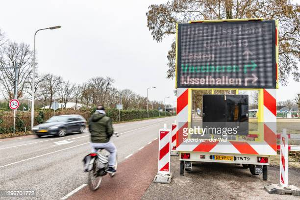 Sign directing to the COVID-19 coronavirus vaccination location for vaccination of healthcare workers by the Region Zwolle GGD IJsselland Dutch...