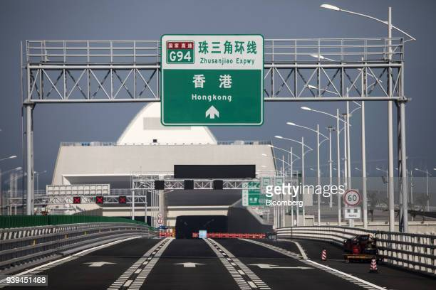 A sign directing traffic to Hong Kong is displayed in front of an entrance to the tunnel on the western artificial island of the Hong KongZhuhaiMacau...