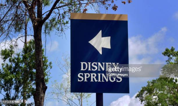 A sign directing visitors to Disney Springs at Walt Disney World is seen a day before the retail dining and entertainment complex begins a phased...