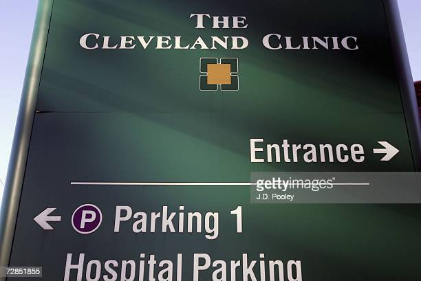 Sign directing visitos to the emergency room stands outside The Cleveland Clinic where Italy's former prime minister Silvio Berlusconi was fitted...