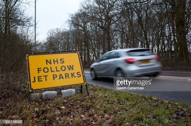 Sign directs cars to an NHS Covid-19 testing facility at Stansted Airport on February 03, 2021 in Stansted, United Kingdom. British leaders have...