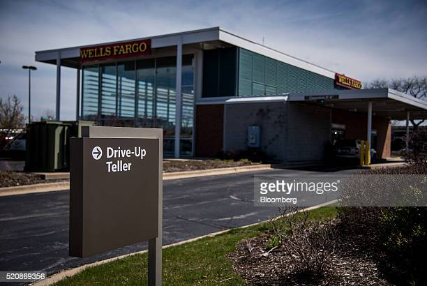 A sign directs customers to the driveup teller at a Wells Fargo Co bank branch in Niles Illinois US on Monday April 11 2016 Wells Fargo Co is...