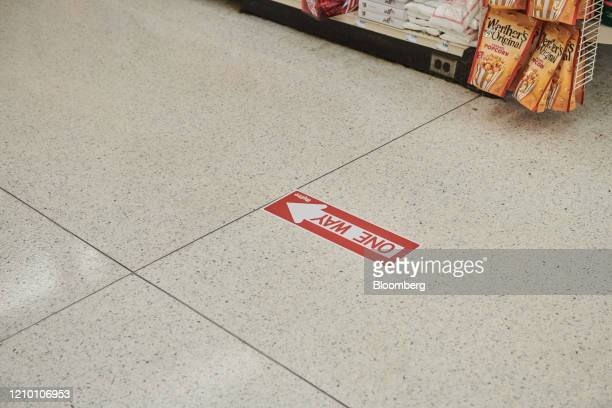 A sign directs customers to walk in one direction at a grocery store in Sioux Falls South Dakota US on Wednesday April 15 2020 South Dakota Governor...