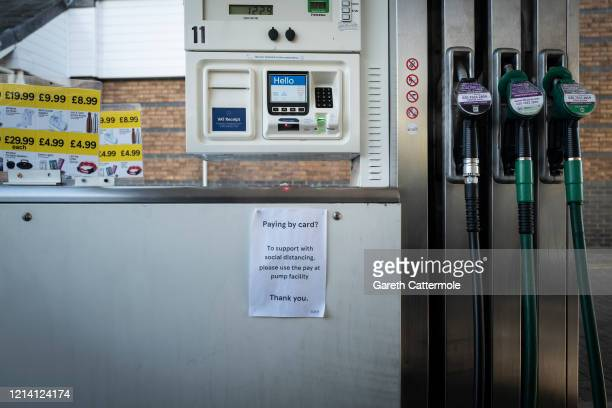 A sign directs how to stop the spread of the coronavirus through social distancing at a Tesco petrol pump on March 22 2020 in Bishop's Stortford...