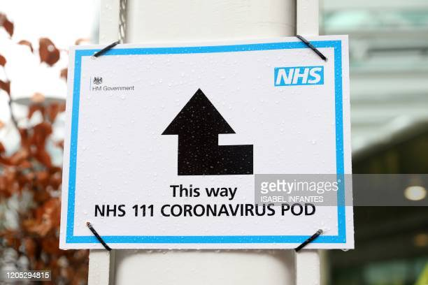 Sign directs patients towards an NHS 111 Coronavirus Pod, where people who believe they may be suffering from the virus can attend and speak to...