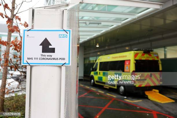 A sign directs patients towards an NHS 111 Coronavirus Pod where people who believe they may be suffering from the virus can attend and speak to...